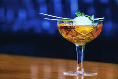 Whiskey Cocktail. Ice ball with mint in retro glass Royalty Free Stock Images