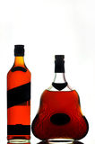 Whiskey and cognac bottles Stock Photos