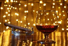 Whiskey, cognac, brandy and cigar on wooden table. Whiskey, cognac, brandy and cigar on wood table stock photos