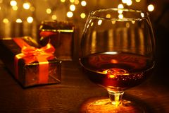 Whiskey, cognac, brandy and gift box on wooden table. Celebration composition on the light background. Stock Photo
