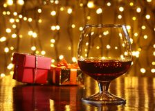 Whiskey, cognac, brandy and gift box on wooden table. Celebration composition on the light background. Royalty Free Stock Photo