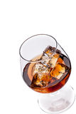 Whiskey / Cognac with Ice Cubes Stock Photos