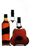 Whiskey cognac and vodka bottles Stock Image