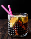 Whiskey Cola Cocktail with lime and ice. cuba libre. Beverage concept Stock Photos