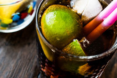 Whiskey Cola Cocktail with lime and ice. cuba libre Stock Images
