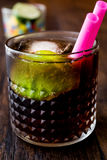 Whiskey Cola Cocktail with lime and ice. cuba libre Royalty Free Stock Image