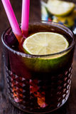 Whiskey Cola Cocktail with lime and ice. cuba libre. Beverage concept Stock Image