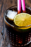 Whiskey Cola Cocktail with lime and ice. cuba libre. Beverage concept Stock Photo
