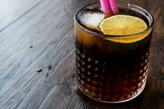 Whiskey Cola Cocktail with lime and ice. cuba libre. Beverage concept Stock Images