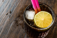 Whiskey Cola Cocktail with lime and ice. cuba libre Royalty Free Stock Images