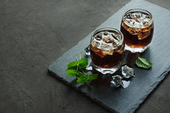 Whiskey and Cola with ice cube Stock Photo