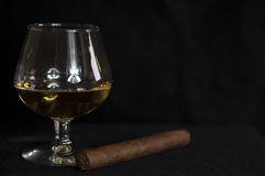 Whiskey and a cuban cigar isolate on black background Stock Photography