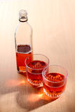 Whiskey cup and bottle royalty free stock photography