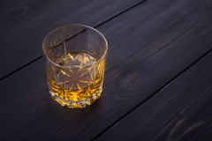 Whiskey on dark wood Royalty Free Stock Photography