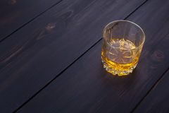 Whiskey on dark wood Stock Photo