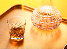 Whiskey and de canter. Whiskey and whiskey de canter and glass on backlit orange Stock Photography