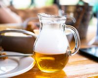 Whiskey decanter. Decanter with whiskey with smoke on a wooden table royalty free stock images