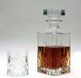 Whiskey Decanter & glass half full with spirit Royalty Free Stock Photography
