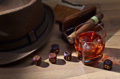 Whiskey and dice. On a wooden table Royalty Free Stock Images