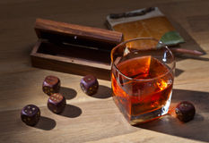 Whiskey and dice Stock Images