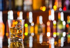 Whiskey drink on bar counter Royalty Free Stock Photos