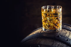 Free Whiskey Drink. Glass Of Whiskey On Old Wooden Barrel Royalty Free Stock Photo - 95758435