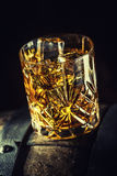 Whiskey drink. Glass of whiskey on old wooden barrel.  royalty free stock photo