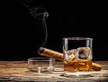 Whiskey. Drink with smoking cigar on wooden table Stock Photo