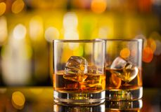Whiskey drinks on bar counter Stock Photos