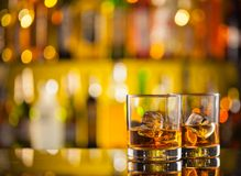 Whiskey drinks on bar counter Royalty Free Stock Photo