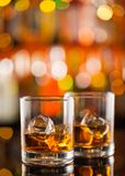 Whiskey drinks on bar counter Royalty Free Stock Images