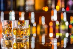 Whiskey drinks on bar counter royalty free stock photography