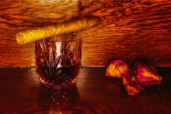 Whiskey drinks with cigars on wooden Royalty Free Stock Photo
