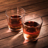 Whiskey drinks on wood table Stock Images
