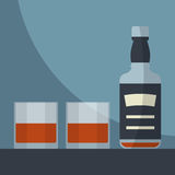 Whiskey empty bottle with two glasses filled. Stock Image