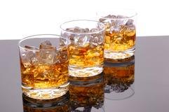 whiskey för exponeringsglas tre arkivfoton