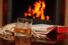 Whiskey by the fireplace stock images