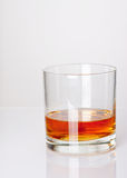 Whiskey in a glass. 2 fingers of whiskey neat in a glass - high key, not isolated Stock Image