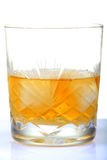 Whiskey glass. Half filled whiskey glass with white background Stock Photos