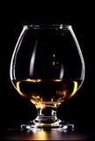 Whiskey Glass. Elegant whiskey glass isolated on black background Royalty Free Stock Photo