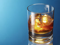 Whiskey glass. On a blue background Stock Photo