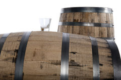 Whiskey glass and barrels Royalty Free Stock Photos