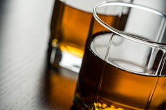Whiskey in glass. On the black table Royalty Free Stock Image