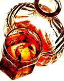 Whiskey Glass and Bottle. Open whiskey bottle and drink with ice Stock Photo