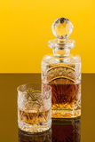 Whiskey Glass & Bottle. A glass and a bottle of whiskey Royalty Free Stock Image