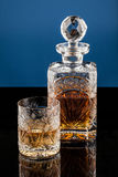 Whiskey Glass & Bottle. A glass and a bottle of whiskey Stock Photography