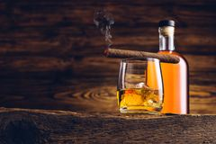 Whiskey glass and bottle on the wooden table Stock Photography