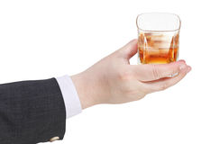 Whiskey glass in businessman hand Royalty Free Stock Photo