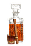 Whiskey glass and cigar. Glass jars with whiskey and cigar on white background stock photo