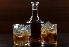 Whiskey glass on darck Stock Images